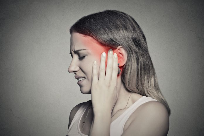 side profile sick female having ear pain touching painful head