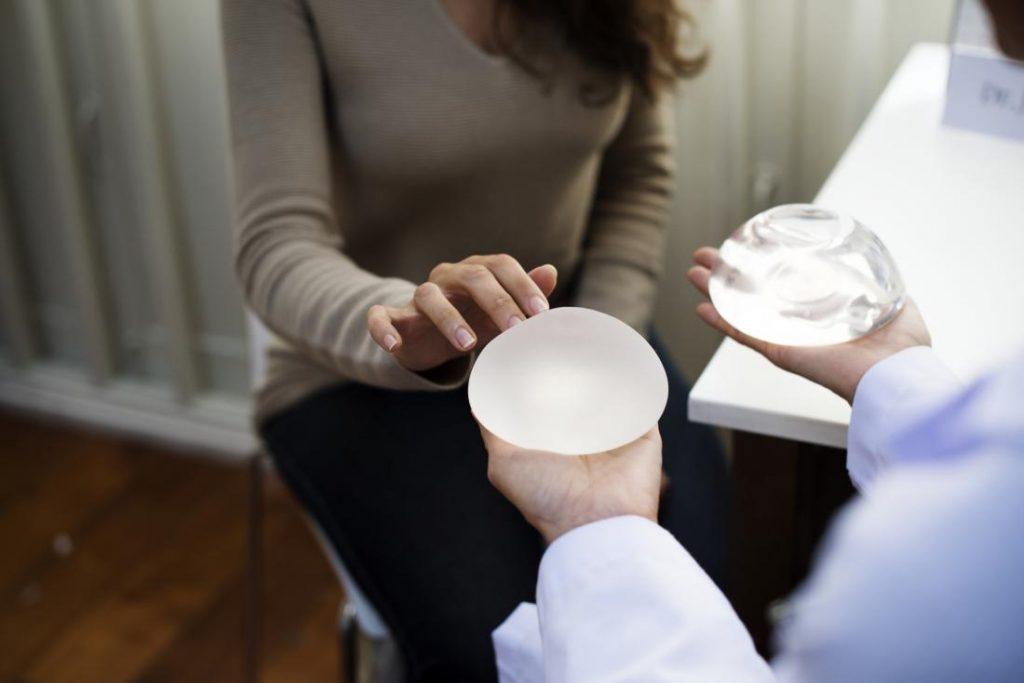 sharp pain after breast augmentation